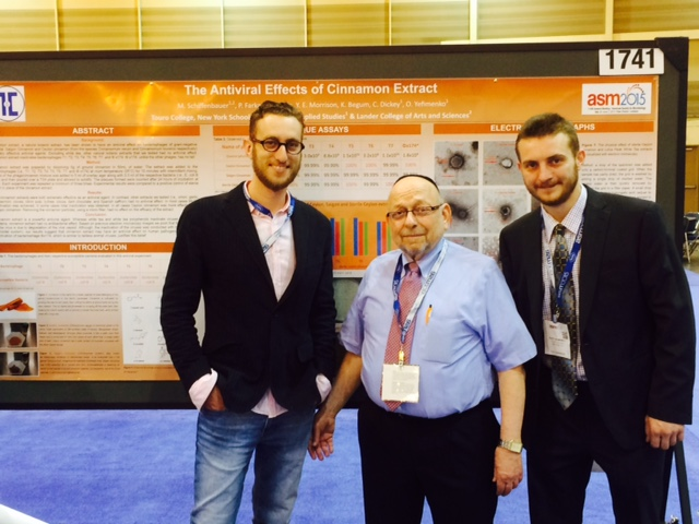 NYSCAS biology professor Dr. Milton Schiffenbauer (middle) with students Oleg Yefimenko (right) and Yehudah Morrison (left), presenting their research at the American Society for Microbiology Annual Meeting in New Orleans.