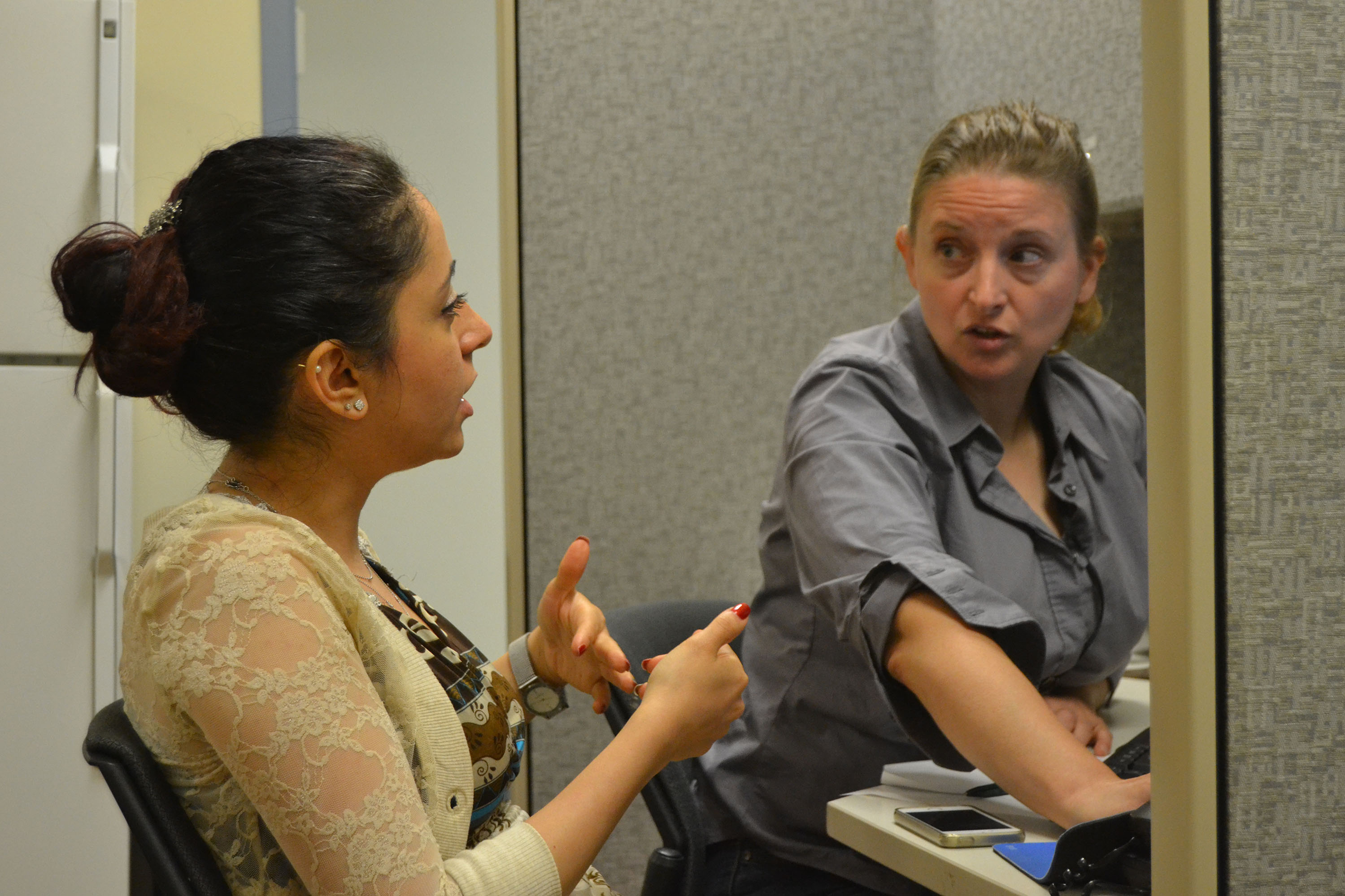 Professor Yannie ten-Broeke (right) brainstorming research ideas with student Behgol