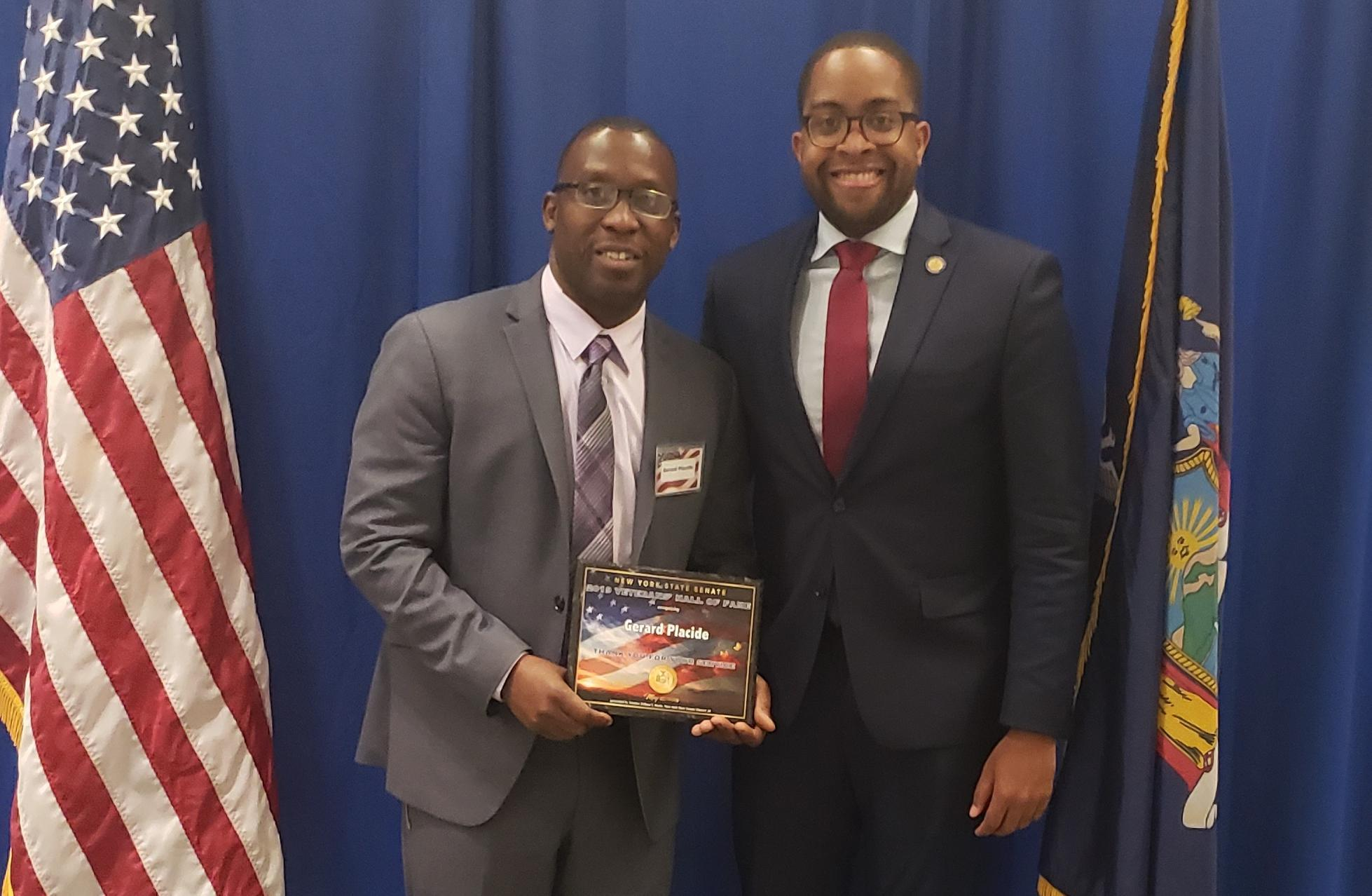 Gerard Placide with Senator Zellnor Myrie at the New York State Senate.