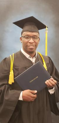 Trying it on for size: Gerard Placide in his cap and gown