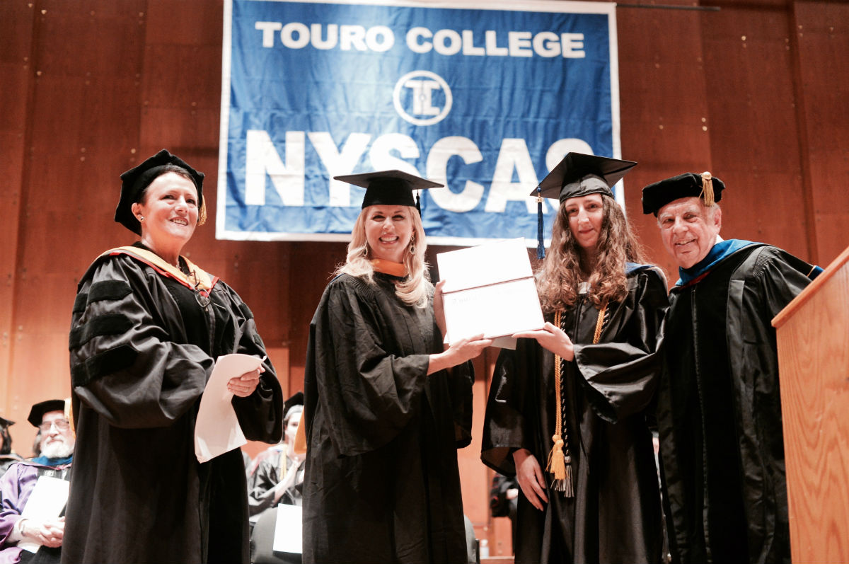 Emmy-award-winning journalist Rita Cosby served as the graduation speaker for the New York School of Career and Applied Studies (NYSCAS) and was honored with the establishment of the Rita Cosby Award presented to Guendalina Almici. From left: Eva Spinelli-Sexter, vice president and executive administrative dean of NYSCAS; Cosby; Almici; Leon Perkal, NYSCAS associate dean of faculties.