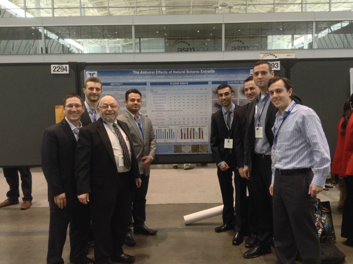 Pinchas Farkas, second from right, with Dr. Milton Schiffenbauer and NYSCAS team that presented research at the American Society for Microbiology annual meeting in Boston.